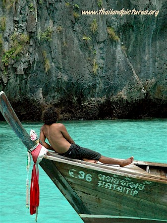 A Thai guide or fisherman just resting on his boat.
