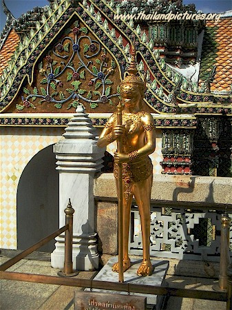 A golden guard located at the Royal Grand Palace in Bangkok, Thailand.