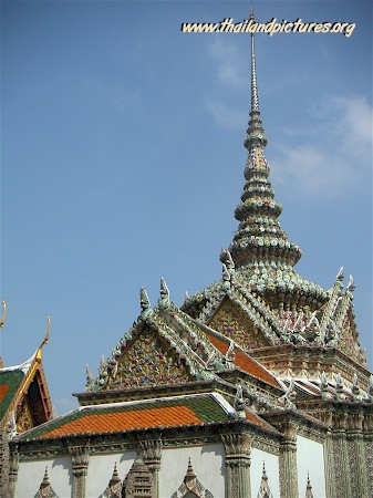 A very well decorated silver tower and temple roof.
